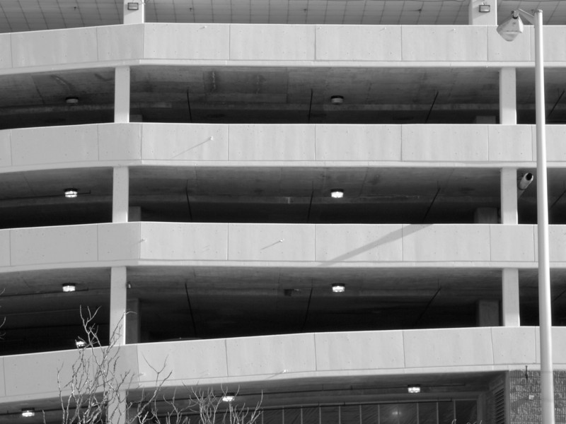 Parking geometry<br /> Why are the lights off on the 4th level?  Who knows.<br /> Manchester NH<br /> Dec 2009