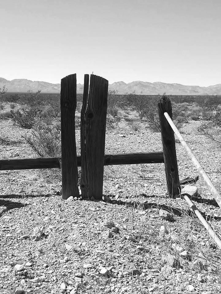 Grave marker shows the passage of time in the harsh, desert environment.  Bullfrog Mine Cemetery near Rhyolite (ghost town) Nevada.  2007.