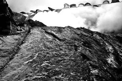 Rocks, ice and prayer flags- the memorials near Dugla