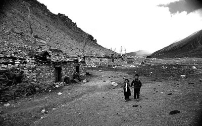 The wind swept village of Muguthang. Kesang and her brother Pemba come to walk to school while their parents graze yaks and sheep high on the mountain pastures.