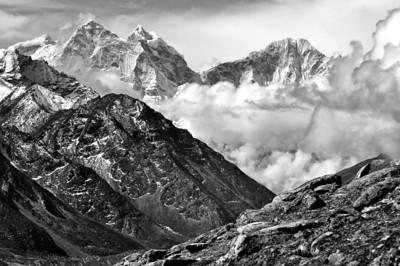 Kangtega and Thamserku rise above the evening storm clouds in the Gokyo valley