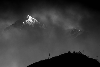 Mount Pandim through storm clouds from  above the Dzongri Hut - the flags of Dzongri top in the photo December 2020
