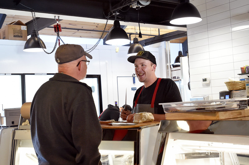 "Nate Singer takes a break from butchering a lamb to talk with a customer at Blackbelly Butcher in Boulder.<br /> For more photos go to  <a href=""http://www.dailycamera.com"">http://www.dailycamera.com</a><br /> Autumn Parry/Staff Photographer<br /> April 21, 2016"