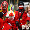 Left to Right: Larry, Elliot, Lou, Logan, Jordan, Emelia, Michael, Andy.<br /> <br /> We all wore red jerseys and face paint, with Indian Headdress for the kids. Media people and fans were taking our pictures all day and we got stopped a few times for interviews. Walking up Clark Street, a taxi driver pulled over and took our picture!