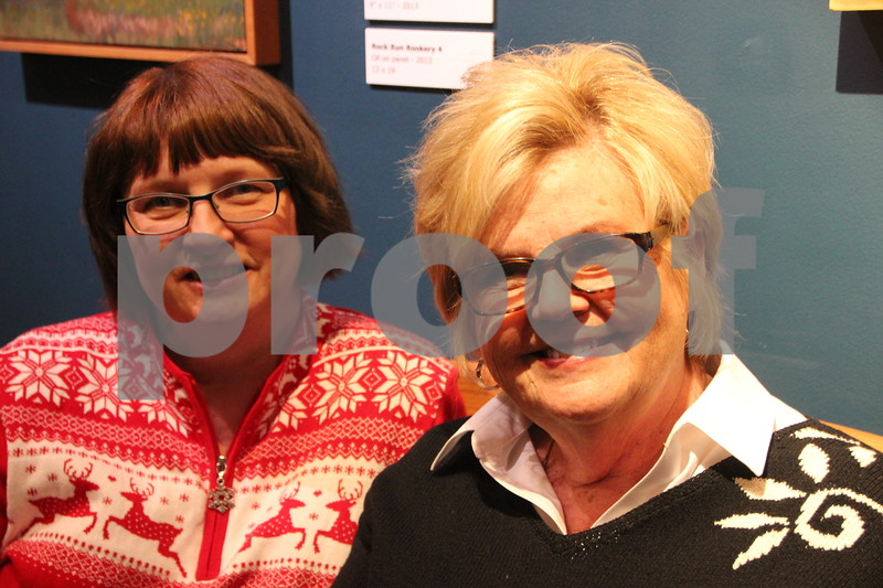Blanden Museum's Christmas Open House was held on Saturday, December 12, 2015 in Fort Dodge. Seen here (left to right) is: Kelly Guderian, and Lin Simpson. There was plenty of refreshments and live music to be enjoyed as well as the great arts and crafts and the artists and crafters who made them on hand. Something for most everyone to enjoy.