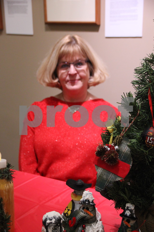 Pictured here is: Marcia Anderson, who was on of the many artists and crafters at Blanden Museum's Christmas Open House, which was held on Saturday, December 12, 2015 in Fort Dodge. She is seen here with a few of her items she made.