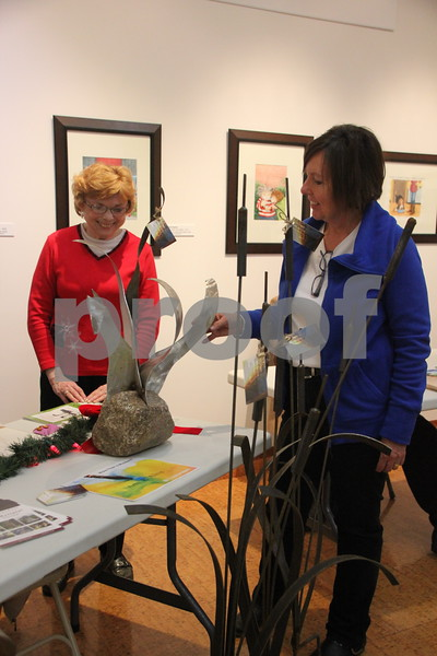 Blanden Museum's Christmas Open House was held on Saturday, December 12, 2015 in Fort Dodge. Seen here (left to right) is: Janet Adams, and Cherry Adams. Janet Adams was one of the many artists on hand and is seen here with  some of the items she made. There was plenty of refreshments and live music to be enjoyed as well as the great arts and crafts and the artists and crafters who made them on hand. Something for most everyone to enjoy.