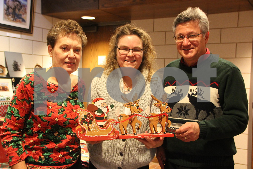 Blanden Museum's Christmas Open House was held on Saturday, December 12, 2015 in Fort Dodge. There was plenty of refreshments and live music to be enjoyed as well as the great arts and crafts and the artists and crafters who made them on hand. Something for most everyone to enjoy. Pictured here is (left to right): Jody Scacci, Meg Beshy, and Michael Scacci.