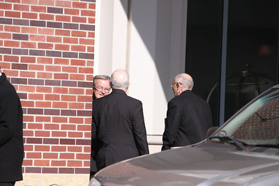 Bishops hide in corner to smoke a cigarette.