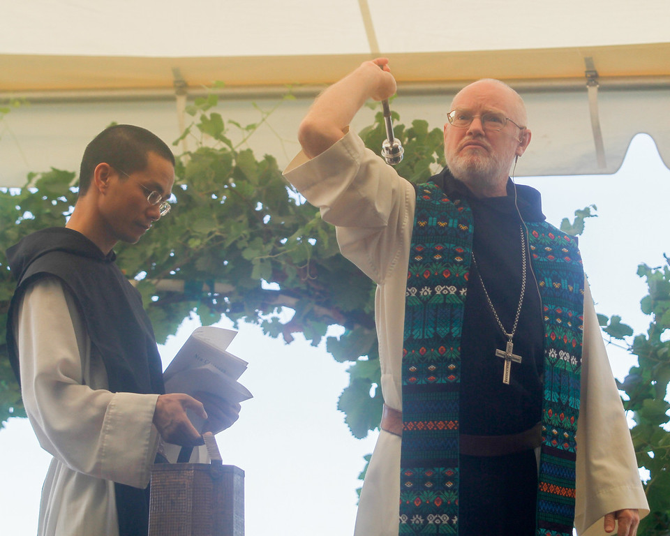 . Abbot Paul Mark Schwan, right, ceremoniously sprinkle holy water to conclude the 11th annual Blessing of the Grapes Saturday July 22, 2017 at the New Clairvaux Vineyard in Vina, California.   (Emily Bertolino -- Enterprise-Record)