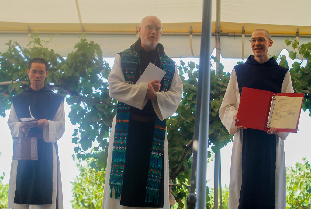 . Abbot Paul Mark Schwan leads a prayer during the 11th annual Blessing of the Grapes Saturday July 22, 2017 at the New Clairvaux Vineyard in Vina, California.   (Emily Bertolino -- Enterprise-Record)
