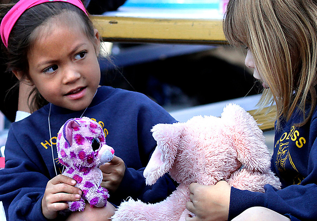 . No animal - live, toy, drawn or imagined - was turned away from The Blessing of the Animals at Holy Cross School on Wednesday.  (Shmuel Thaler -- Santa Cruz Sentinel)
