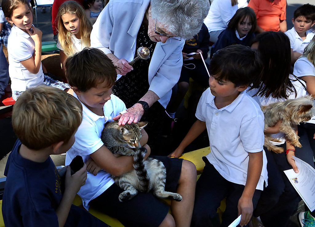 . Sister Barbara Long anoints a cat with holy water during the Blessing of the Animals Wednesday. (Shmuel Thaler -- Santa Cruz Sentinel)
