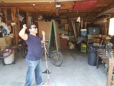 Louis demonstrating his dart playing skills...