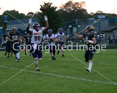 Advance 2 #88 Nick Ostas with defensive pressure on Columbia Central's quarterback
