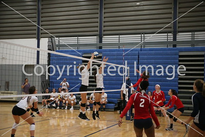 Cara Andrix and Lauren Henning block the spike attempt