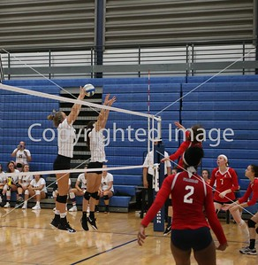 Cara Andrix and Lauren Henning block the spike attempt against Franklin High School