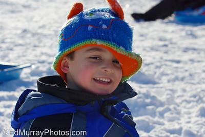 Jake Murray Having fun sledding at the Veterans School