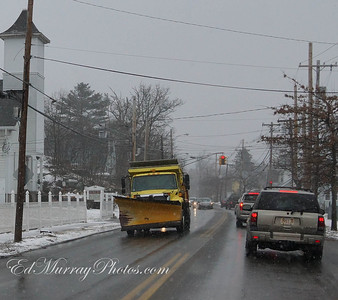 a snow plows getting into position on Main Street
