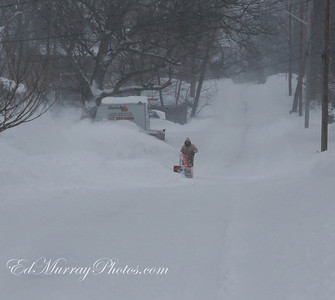 A lone snow blower on Clifton Ave