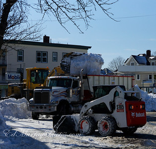 A front end loader fill a waiting dump truck