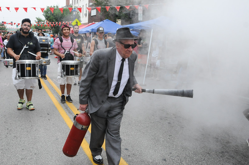John Strickler - Digital First Media<br /> George Muller leads the way protecting Phoenxiville from The Blob as he sprays his fire extinguisher with the Mad Beatz Drummers marching behind him during the fire extinguisher parade.
