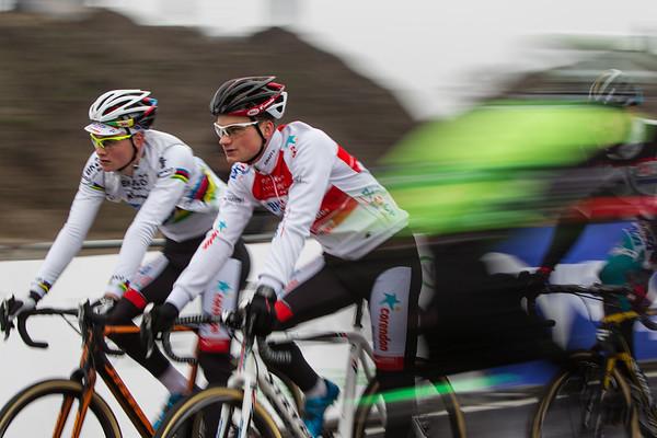 Mathieu van der Poel  (left) caught in a warm up motion blur.