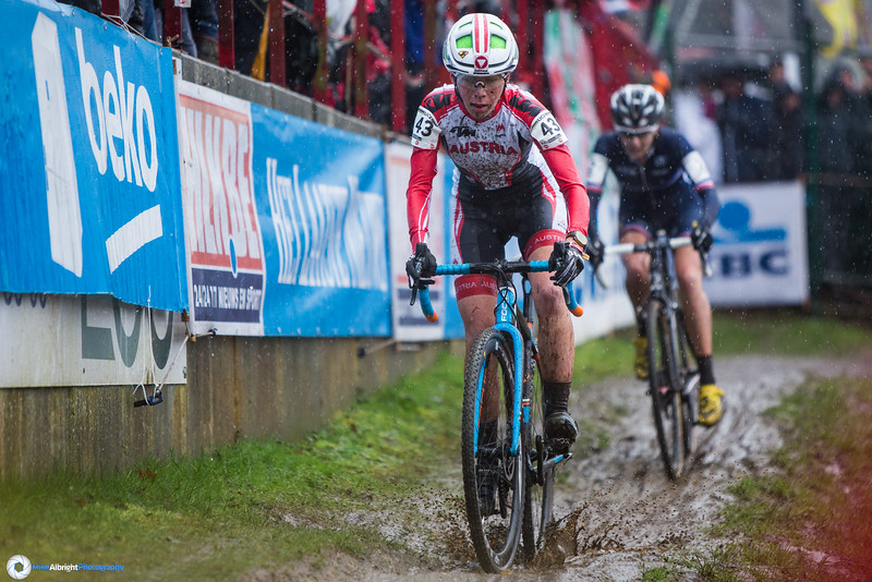 Nadja Heigl (AUT) splashes through a puddle on the off-camber section.