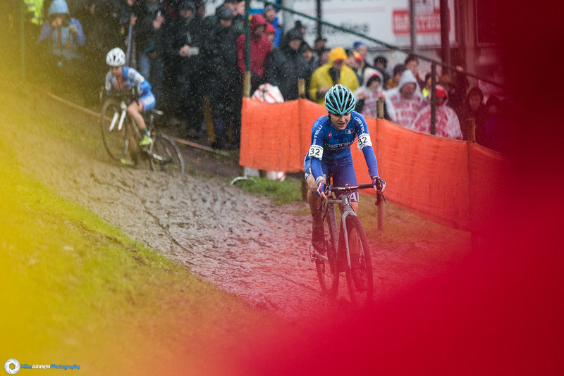 Chiara Teocchi (ITA), shot through the crowd, using their rain slickers as a frame.