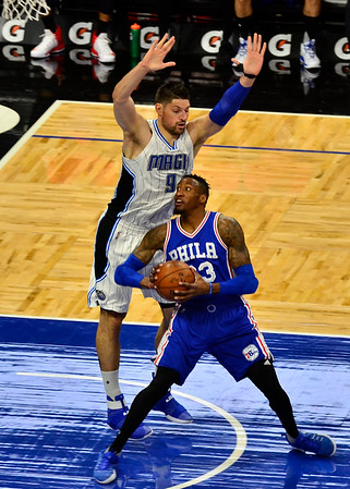 Philadelphia 76ers forward Robert Covington attempts to drive past Orlando Magic forward Nikola Vucevic at the Amway Center in Orlando, Fl.