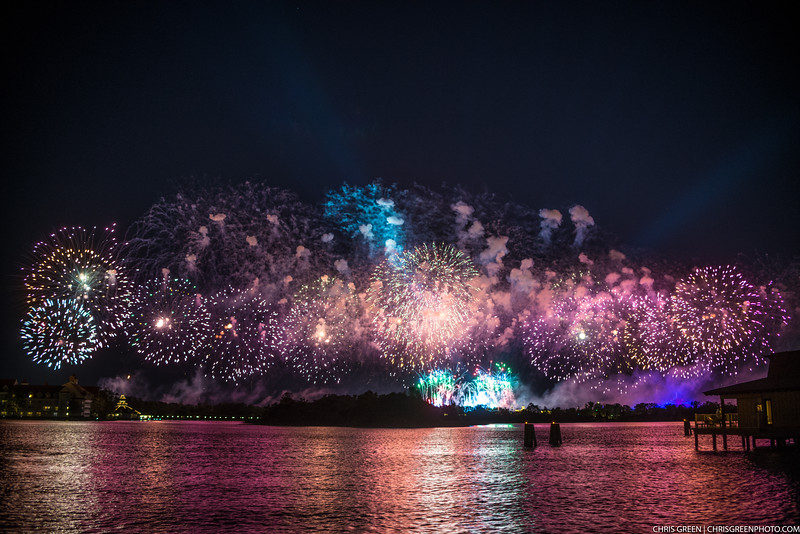 Perimeter fireworks erupt and light up the night sky over Disney's Magic Kingdom on New Years Eve, as seen from Disney's Polynesian Village Resort.