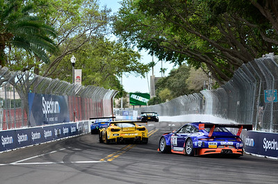 The GMG Racing Porsche RSR GT3 of Alec Udell (17) chases the Ferrari 488 GT3 of Daniel Mancinelli of TR3 Racing past Al Lang Stadium during the Firestone Grand Prix of St. Petersburg weekend in St. Petersburg, Fl.