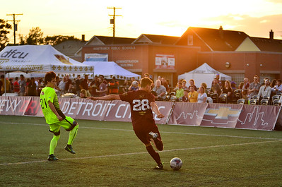 Detroit City FC forward Tyler Moorman takes a shot at goal against Grand Rapids FC at Keyworth Stadium in Detroit, MI.