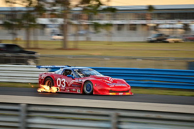 Fire pours from the exhaust of Jim McAleese's Chevrolet Corvette during qualifying for the Trans-Am Series presented by Pirelli at Sebring International Raceway.