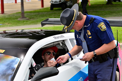 Fields Racing's Kyle Marcelli is known for being fast, but he was reminded to slow down when not on the track by this Michigan State Police officer in between practice sessions at the Chevrolet Detroit Grand Prix Presented by Lear.