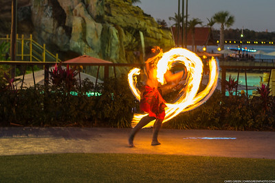 A Polynesian fire dancer performs in front of resort guests at Disney's Polynesian Village Resort during the nightly torch lighting ceremony.