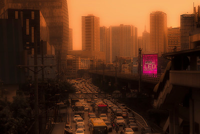 Smog doesn't technically count as weather, but combining it with golden hour sunlight and exaggerating the colors in post processing makes for a Blade Runner 2049-ish scene.