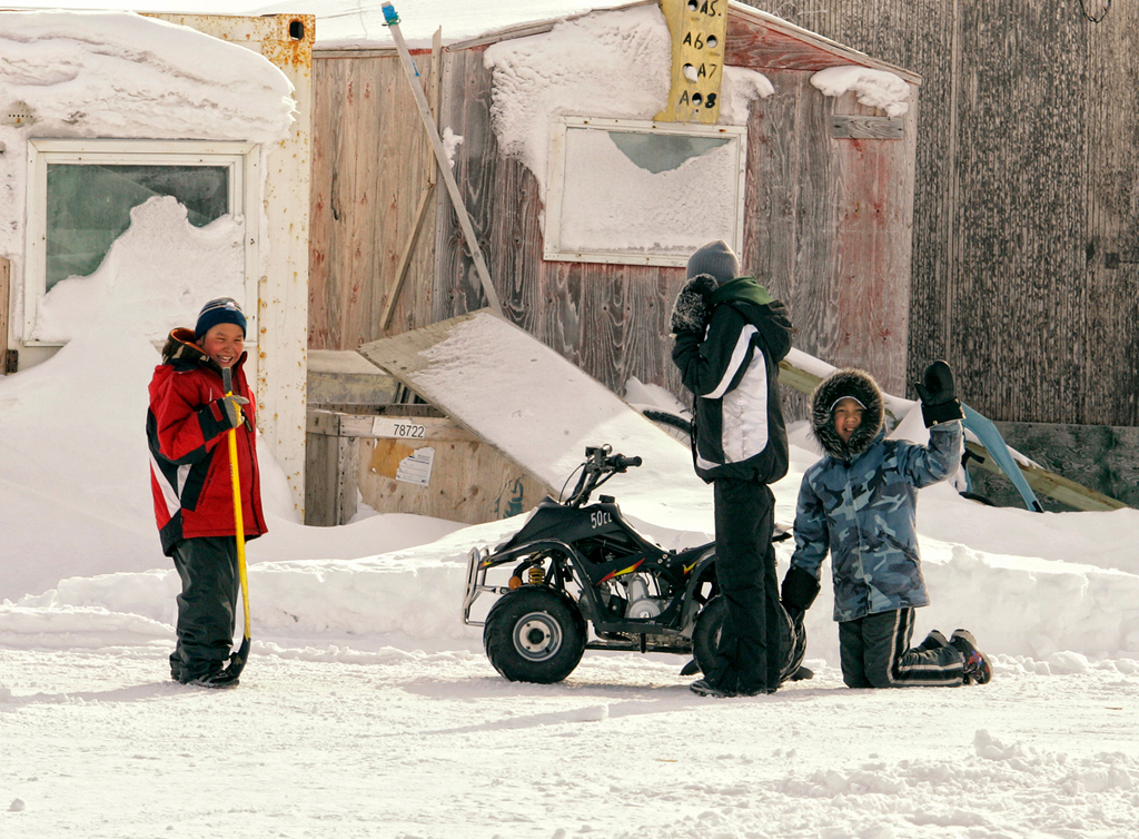 Kids playing with a cool 4-wheeler in Hall Beach, Nunavut.
