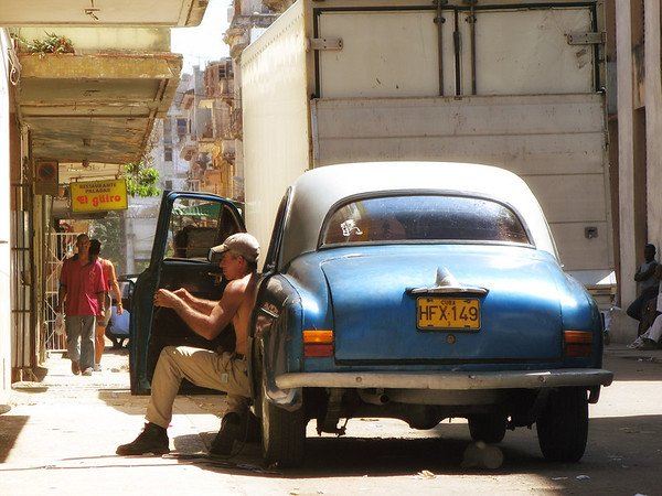 Cuban mechanic. In Cuba if you own a car, you are a mechanic. The cars are constantly being repaired.