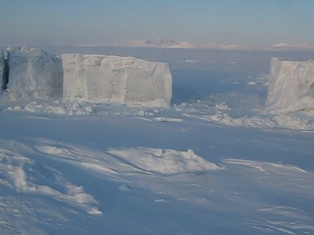 A video shot from a helicopter of giant ice formations. They are much bigger than they appear. If we had more time up there the pilot said he would land one of the helicopters on top of them to give it some scale. They were only 20 people at the camp but 5 helicopters.