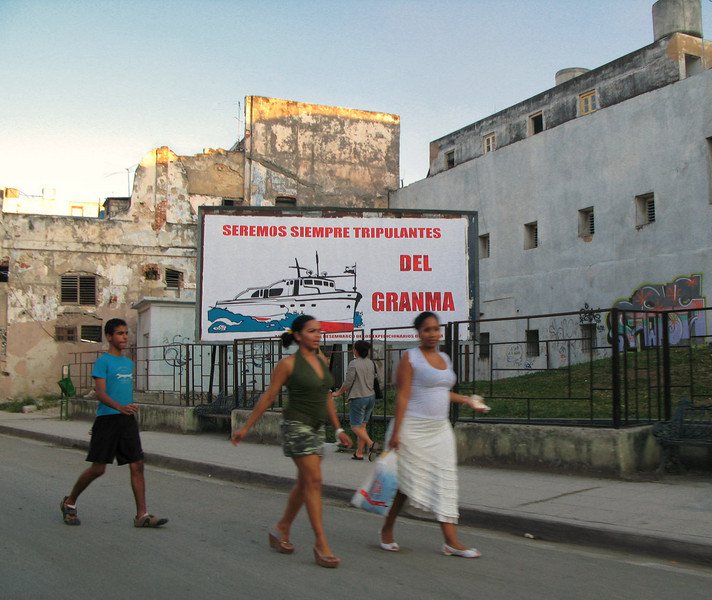 "There isn't much advertising in Cuba, just propaganda. The sign says, ""We will always be crew members of the Granma."" Granma is the yacht in which Fidel Castro and his revolutionary expedition sailed to Cuba in 1956."