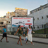 """There isn't much advertising in Cuba, just propaganda. The sign says, """"We will always be crew members of the Granma."""" Granma is the yacht in which Fidel Castro and his revolutionary expedition sailed to Cuba in 1956."""