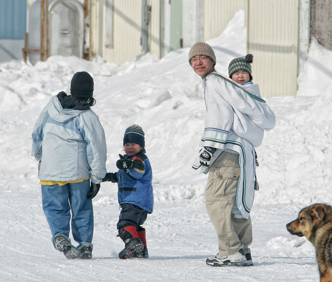 An Inuit family in Hall Beach, Nunavut. Everyone seemed to have a really nice dog.