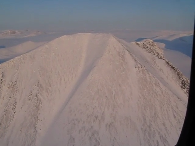 A video taken from a helicopter of the mountains at the top of Ellesmere Island. Near the North Pole.