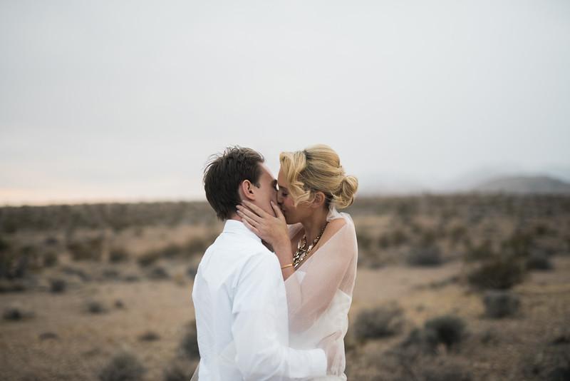 KRISTEN KAY PHOTOGRAPHY | Las Vegas rainy cloudy desert elopement first kiss
