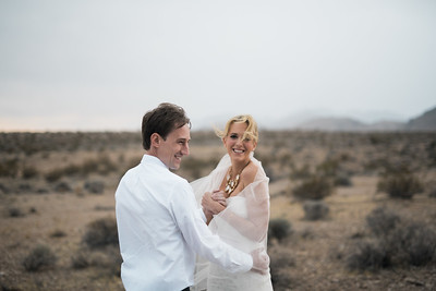 KRISTEN KAY PHOTOGRAPHY | Las Vegas rainy cloudy desert elopement, happy couple