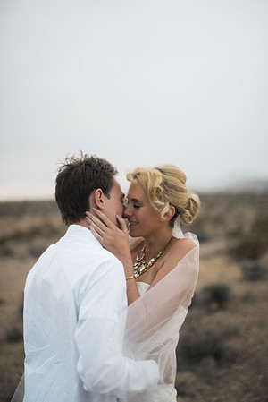 KRISTEN KAY PHOTOGRAPHY   Las Vegas rainy cloudy desert elopement first kiss
