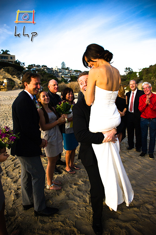 The hug following the kiss that followed the ceremony in the Little Corona Del Mar Beach