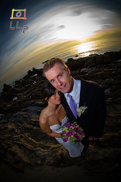 Fish-eye wedding portrait on the beach