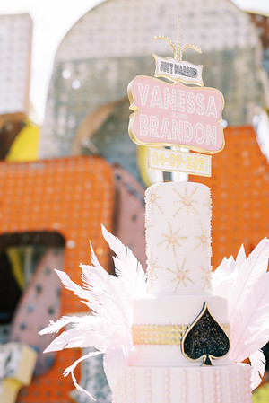 vintage Neon Museum inspired fun wedding cake with pink feathers and a custom neon sign - Neon Museum Wedding Venue Las Vegas - Kristen Kay Photography - Photo and Super 8 Video